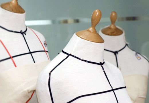Three sewing mannequins.