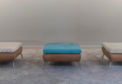 Three design sofas in an empty room.